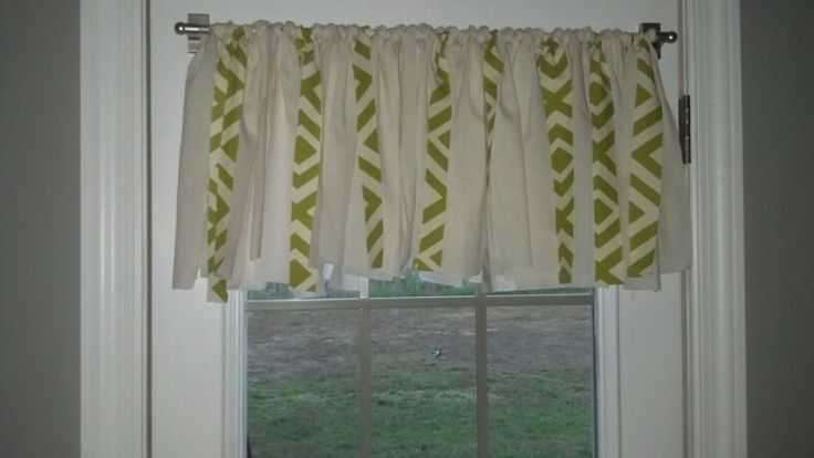 DIY valance made from strips of fabric. I had some left from the curtains I made in the living room so the strips with green compliment the other curtains in the room. I just used a magnetic curtain rod since we have a steel door.