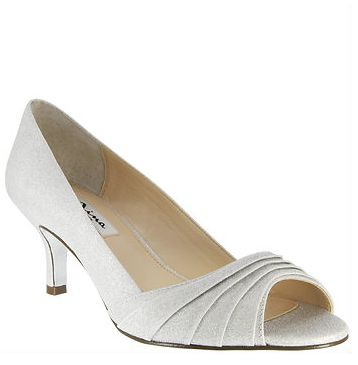 The Carolyn pump is an elegant and sophisticated choice done in a beautiful silver luster satin fabric. The low heel height, color, and comfort make her the perfect low pump for dancing all night or comfortably staying on your feet for any festive occasion from a wedding to a holiday party! The Carolyn in silver luster satin fabric is one of our wedding shoe favorites for 2016! | Nina Shoes | Carolyn…