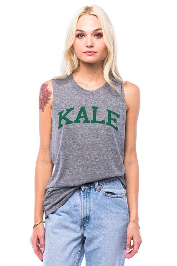 Triblend jersey muscle tank with the original KALE graphic. Triblend Cotton/Poly/Rayon Loose Fit Machine Wash Fit Guide Seen on Kaley Cuoco, Lucy Hale, Beyonce, Rihanna, Bella Thorne, Lena Dunham, Rac
