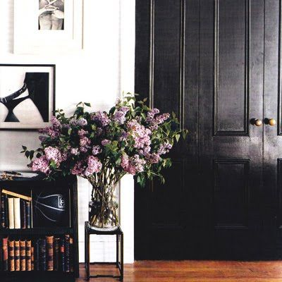 Black doors, flowers. I remember this amazing spread in Domino magazine.