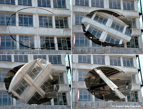 A building with a revolving portion so the inside comes out, part of a biennial year art installation
