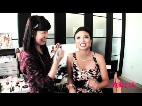 Jeannie Mai, host of How Do I Look on the Style Network, shares the magic of glossy lips demonstrated by her personal makeup artist Uzmee Karakovszki.