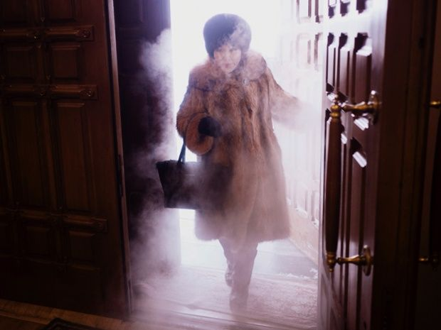 Yakutsk: the coldest city in the world. A local woman enters Preobrazhensky Cathedral in a swirl of freezing mist.