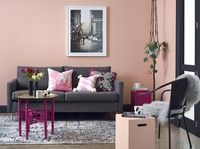 Architraves and trims in Resene Nero (black) save this room from being too feminine, even when hot pink accents are used. The walls and front peg stool are in Resene Dawn Chorus, the coffee table base and second peg stool are in Resene Irresistible. The slim vases are Resene Nero. The sofa is from The Mood Store and other accessories are from Collected.