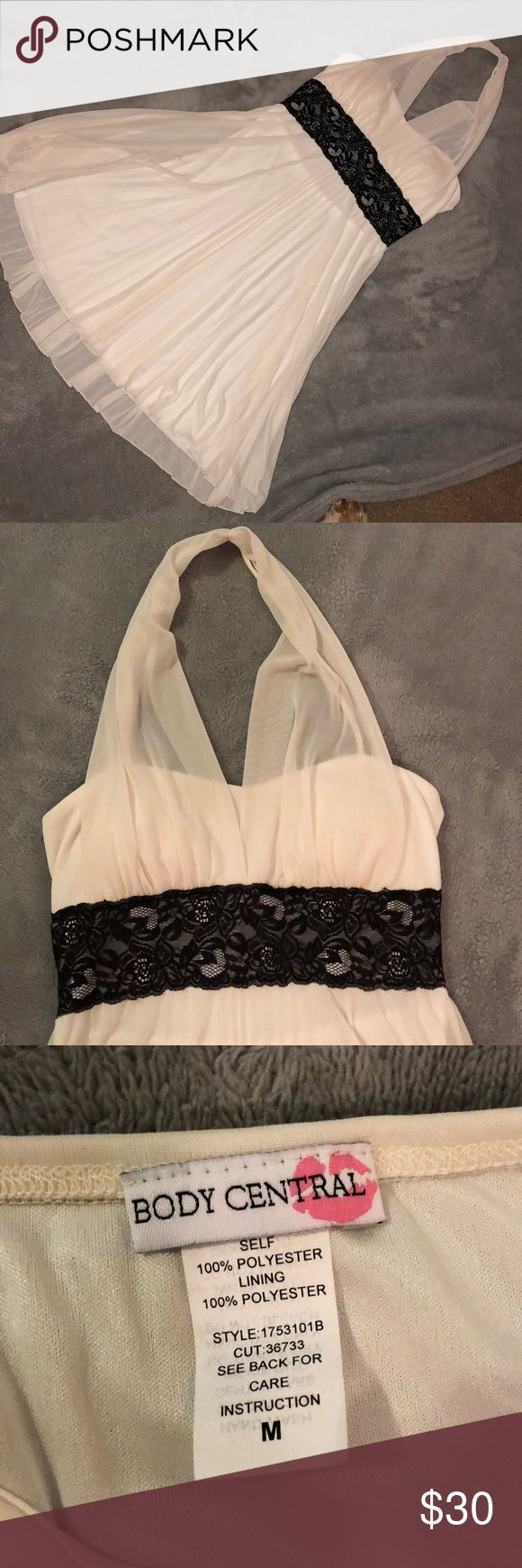 Formal Marilyn Monroe style dress This gorgeous halter dress is the perfect dress for any formal event. It's cream with a sheer outer lining. The bust area has lined cups. Very stretchy and comfortable. It's in good condition from a smoke free home. Body Central Dresses