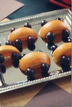 Racecar treats made from oranges and grapes