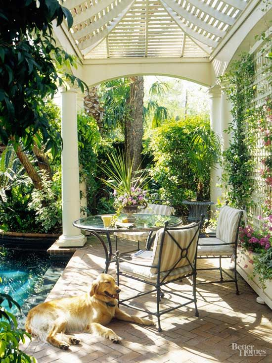 This pavilion has a formal, traditional look that is in keeping with the pool style. The tropical plantings, however, create romance and mystery. With columns next to palm trees, the area feels less like a backyard pool and more like a hidden pond in the jungle.