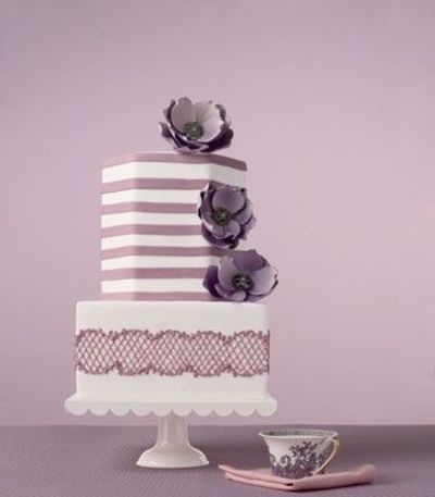 square, hexagonal shaped wedding cake. pretty purple wedding cake.