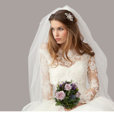Stunning long sleeve lace wedding dress from Mirror Mirror couture. Simply beautiful. www.handbag.com