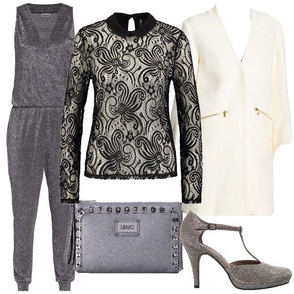 Una bellissima tuta jumpsuit argento è la protagonista di questo look da sera. La tuta è indossata sopra ad una camicetta di pizzo elasticizzato trasparente e con un giaccone color panna. Le décolleté con il cinturino platino e una piccola pochette grigia completano il look.