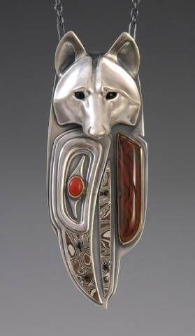 Brooke Stone Jewelry   Silver Gray Wolf/ Raven Spirit   .  Silver, mokume beak, Red jasper, Oxblood coral.