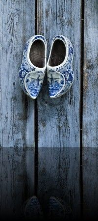 Delft Shoes, In the past the Dutch farmers walked on wooden shoes. Some of them still do that, but nowadays most of the people are wearing normal shoes. Nevertheless, a lot of people still think they are wearing wooden shoes every day.