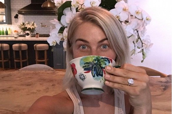Julianne Hough wears her oval cut engagement ring and a lacey tank top