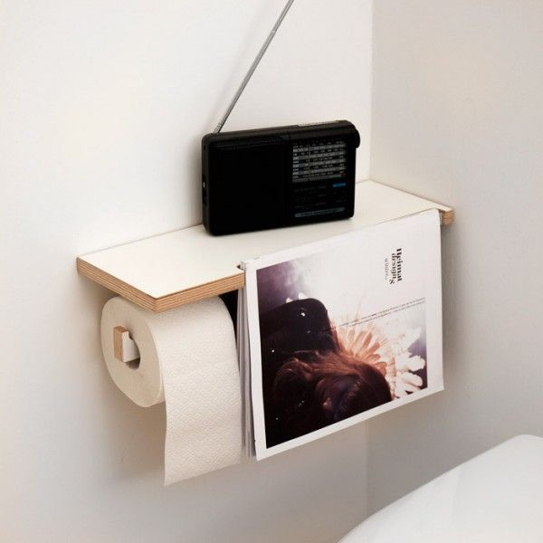 Toilet paper holder, shelf and magazine rest...clever!! The magazine rest hides two more rolls behind it...