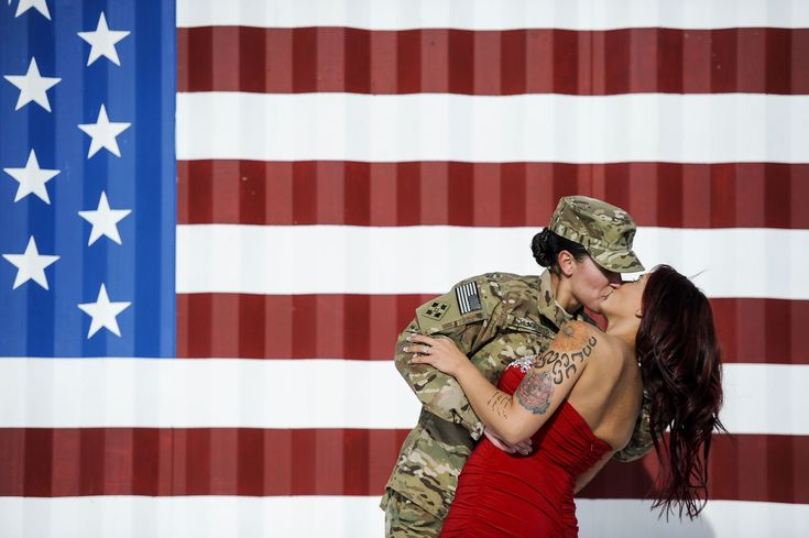 Spc. Sabryna Schlagetter, left, kisses her wife, Cheyenne Schlagetter, after returning home to Fort Carson with about 135 members of the 4th Infantry Brigade Combat Team, 4th Infantry Division Frid...
