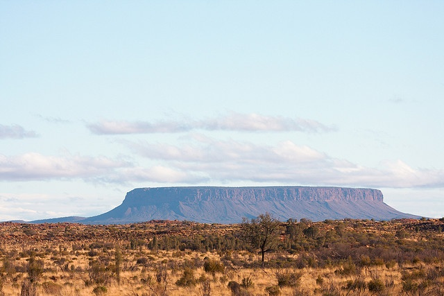 Mount Conner is a flat-topped and horseshoe-shaped mountain. It is often confused with Uluru, since it can be seen from the road to Uluru and Kata Tjuta , when approaching from Alice Springs.