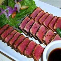 Seared Ahi Tuna Steaks @ Allrecipes.com. This was a good experience. The fish cooked incredibly fast and was delicious, but I added too much salt. Which was really easy to do. Next time I am just going to coat in cayenne pepper, then sprinkle a little salt on.