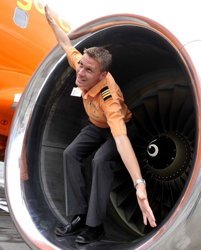 Mango Airlines cabin crew member pretending he's a plane in the engine