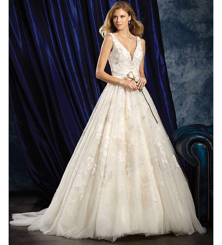Every princess bride needs a fairy tale ball gown to wear on their wedding day and Alfred Angelo's floral design fits the bill perfectly. The structured bodice is the perfect choice to uphold a low cut neckline and the full tulle skirt is oozing with romance.