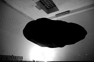Black shape, floating.  Garage Nardini.  Infart fest 2011, Bassano del Grappa.
