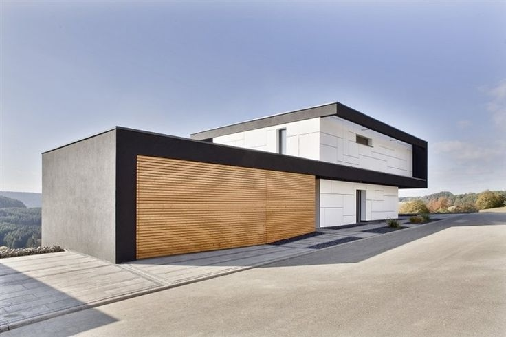 Black, white and beach, love this colour pallet for inside or out. Passive House by Daniel Stauch