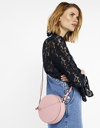 Add this season's sugar-sweet pastel shades to your outfits with our Norton circle bag. This round cross-body has a minimal design with a front pocket and to...