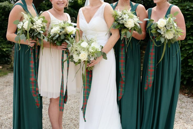 White bouquets and eucalyptus - Image by Dasha Caffrey - Rustic Wedding With Tartan Accents And Bride In Elegant Gown From Go Bridal With A Sassi Holford Veil And Rachel Simpson Shoes With Groom And Groomsmen In Kilts