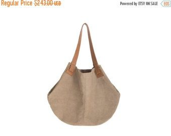 VALENTINES DAY SALE! 20%-40% OFF DISCOUNT ON THE ENTIRE SHOP!     Original price: 270$ On sale: 243$    Carolina bag is a leather tote, handmade in our studio from the beginning to the end. SIMPLE&STYLISH&STANDING OUT    We use soft genuine leather. This bag is perfect as your everyday bag, which can fit for a 13-15 inches laptop, an IPAD, A4 files, books, magazines, cosmetic bag as well as many accessories.    materials: Nubuck soft leather , the handles are from natural leather.    ...