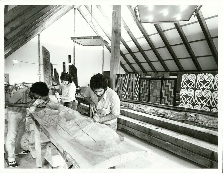 Carvers at work on Poupou inside new Meeting House at the Orakei Marae, Auckland   by Archives New Zealand
