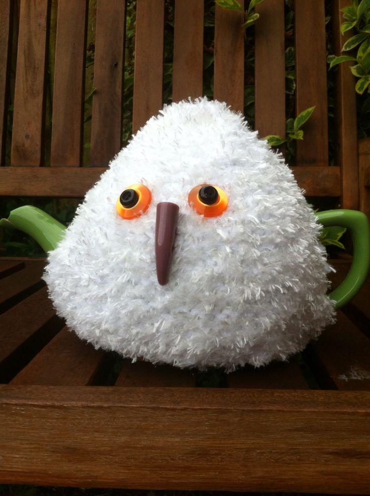 Snowy owl tea cosy