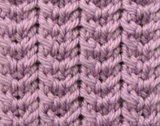 Checkmark Ribs - Stitch Sample - Beautiful and easy rib stitch created with simple 2-stitch back and front cables. Makes a rather non-stretchy fabric.
