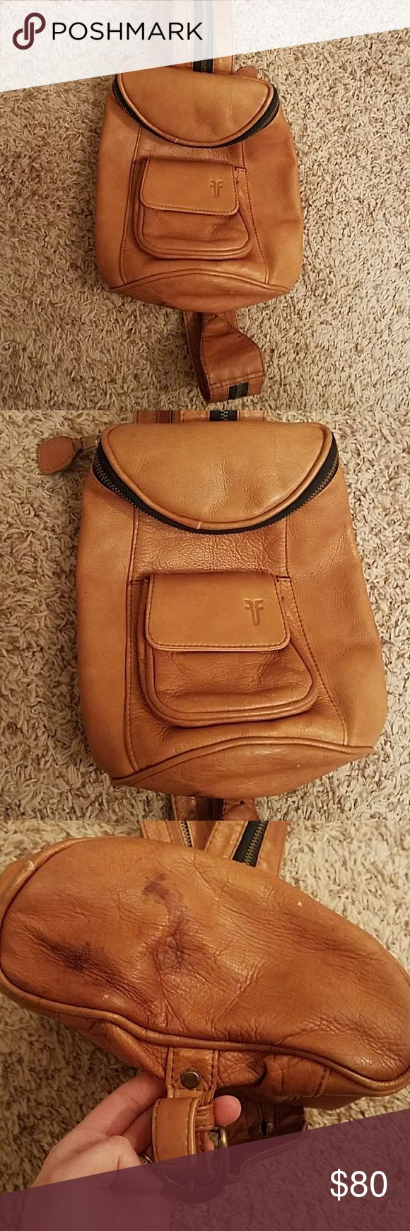 Vintage Frye Leather Mini Convertible Backpack Tan leather convertible backpack. Can be worn over one shoulder or zipped down the center of the strap to make a two shoulder backpack. Small button pouch on the front. Small zipper pouch attached inside. Worn and loved condition but with leather it looks beautiful! Perfect for summer music festivals! Some small imperfections, tried to picture as best I could. Frye Bags Backpacks