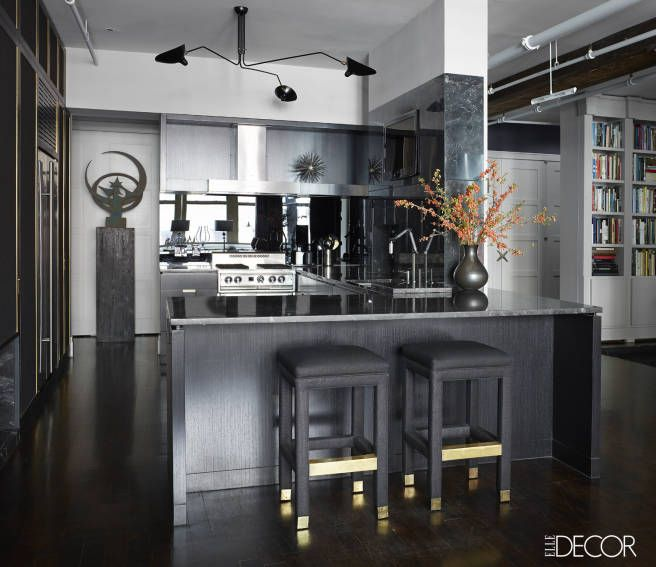 Why restrict yourself to the light-colored granite of yesteryear? Black is the way of the future: Black cabinetry, black countertops, black stools. It's brave, to be sure, but it's the kind of daring that just makes sense.