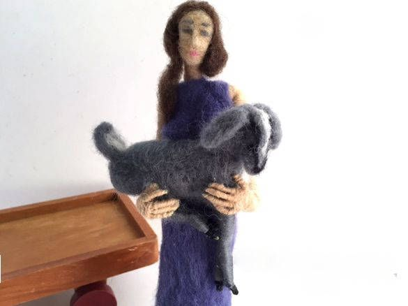 Girl with Goat - needle felted doll holding needle felted goat. Posable soft sculpture over wire armature.   She is humble yet reaching for a greater height - a greater wisdom...  This rustic minimalist decor doll is made with with love and care. Her frame is made with a wire armature covered with wool roving. The body form is then needle felted with a variety of coloured natural wool. She stands 7 inches (18cm) tall with her upper torso being posable.  The goat is also made over wire…