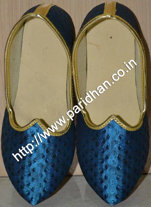 Fashionable wedding mojari made in silver green color polyester fabric.
