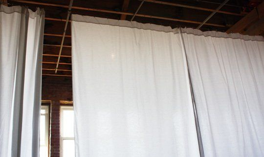 How To Hang 30' Of Curtains For $40. This idea ould be used along a wall, straight or otherwise to create a nice ceiling to floor curtain to act as an accent.