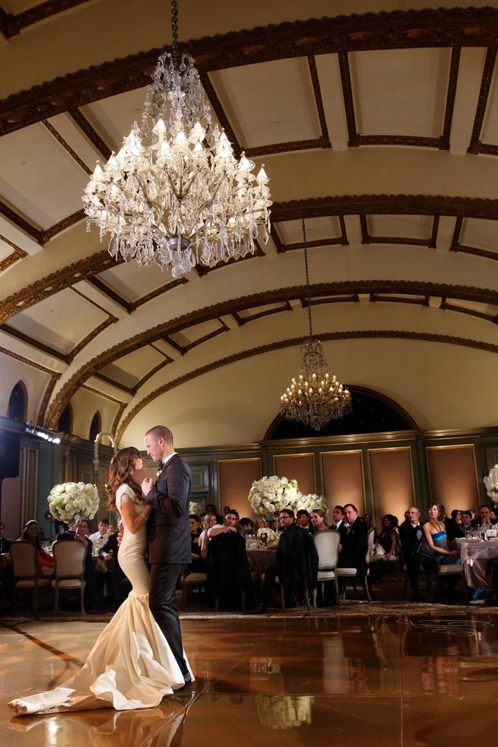 "The Bachelorette's Ashley Hebert & J.P. Rosenbaum shared their first dance beneath a crystal chandelier suspended from an arched-ceiling to ""Love"" by Matt White. #WeddingCouple Photography: Bob & Dawn Davis Photography. Read More:  http://www.insideweddings.com/weddings/ashley-hebert-and-jp-rosenbaum/438/"