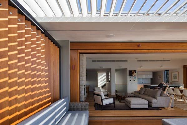 An open plan living room and deck designed for families. Scyon™ Matrix™ overhead.