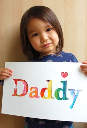 Father's Day sign/card using child's artwork taped behind cut-out letters.  Beautiful!