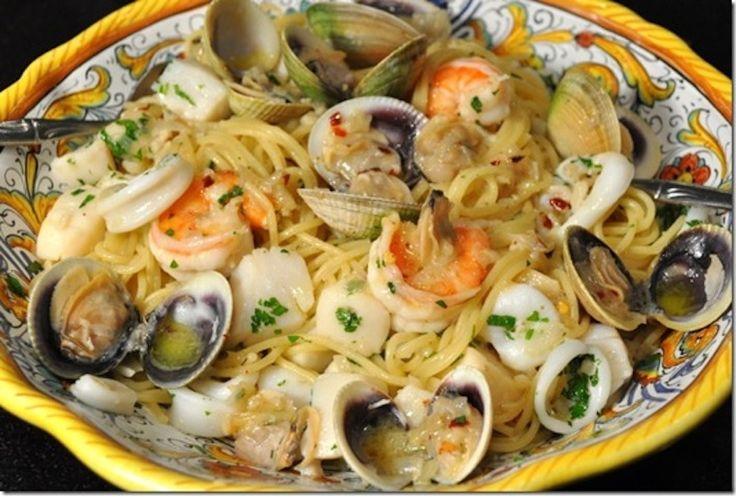 The Feast of the Seven Fishes (Italian: Festa dei sette pesci), also known as The Vigil (Italian: La Vigilia), is a celebration of Christmas Eve with meals of fish and other seafood. (via wikipedia.) Here is the recipe for Spaghetti Ai Frutti Di Mare! #Seafood #Pasta