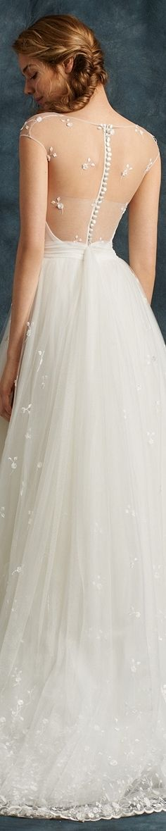 Atelier Eme Bridal 2017 Midi dress with dipped hem. The sweetheart bodice in lustrous crepe cady is veiled in a textured thread-embroidered lace overlay to create a Sabrina neckline and train at the back. Featuring cap sleeves, an illusion back and exquisite button detail down the centre back. The full ball gown skirt in embroidered lace features generous textured detailing at the hemline that gradually fades away towards the waist.