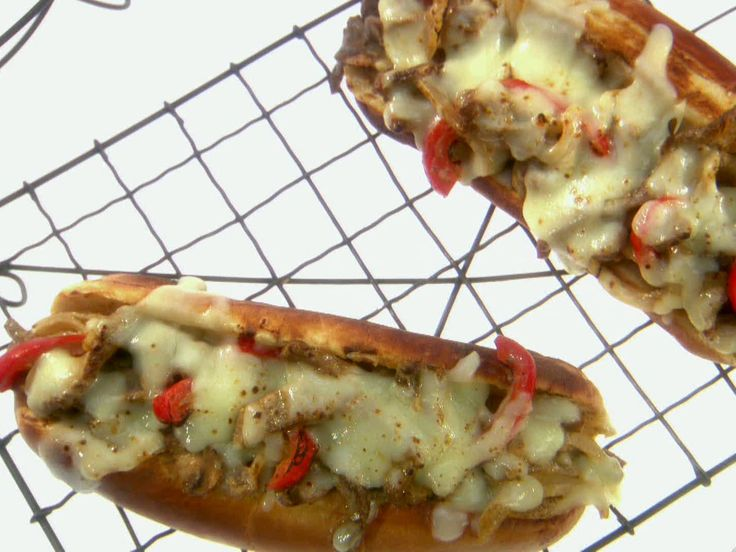 Three Cheesesteak Sandwiches from FoodNetwork.com - Three cheese! American, cream cheese (yes!) and mozzarella!  Can't wait to try!