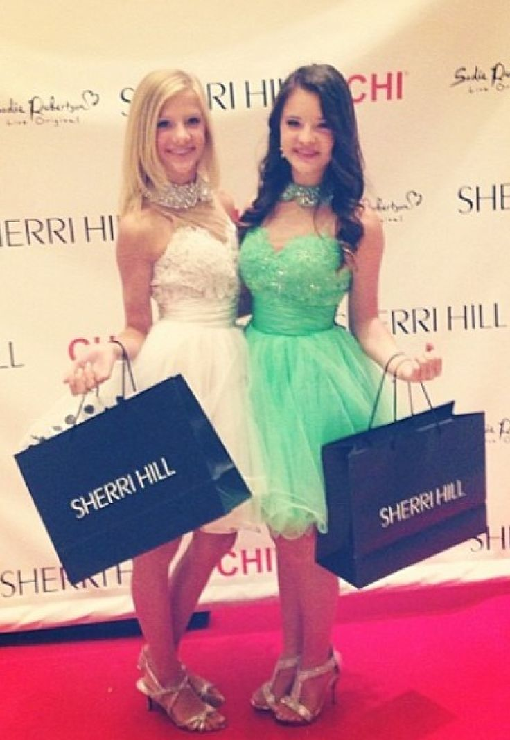 Paige and Brooke representing Sherri Hill at fashion week ...