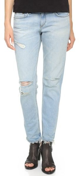 Whiskering, shredded holes, and raw cuffs lend distressed charm to these slouchy Rag & Bone/JEAN jeans. 5-pocket styling. Single-button closure and zip fly. Fabric: Denim. 100% cotton. Wash cold. Made in the United States. #youhabit #31aJq947B