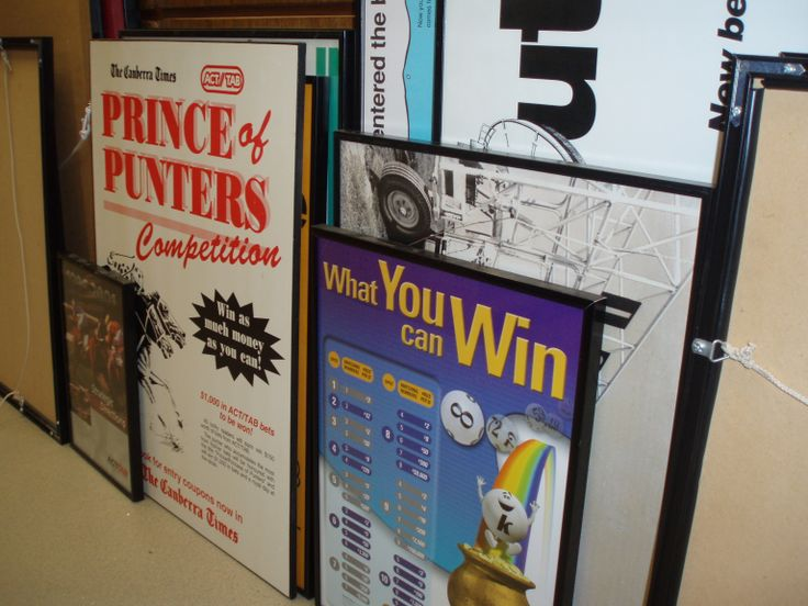 Framed posters (waiting to be unframed for preservation)