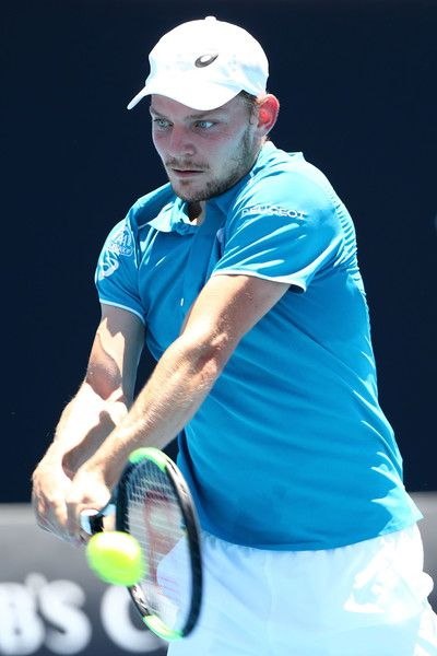 David Goffin Photos - David Goffin of Belgium plays a backhand in his first round match against Matthias Bachinger of Germany on day two of the 2018 Australian Open at Melbourne Park on January 16, 2018 in Melbourne, Australia. - 2018 Australian Open - Day 2