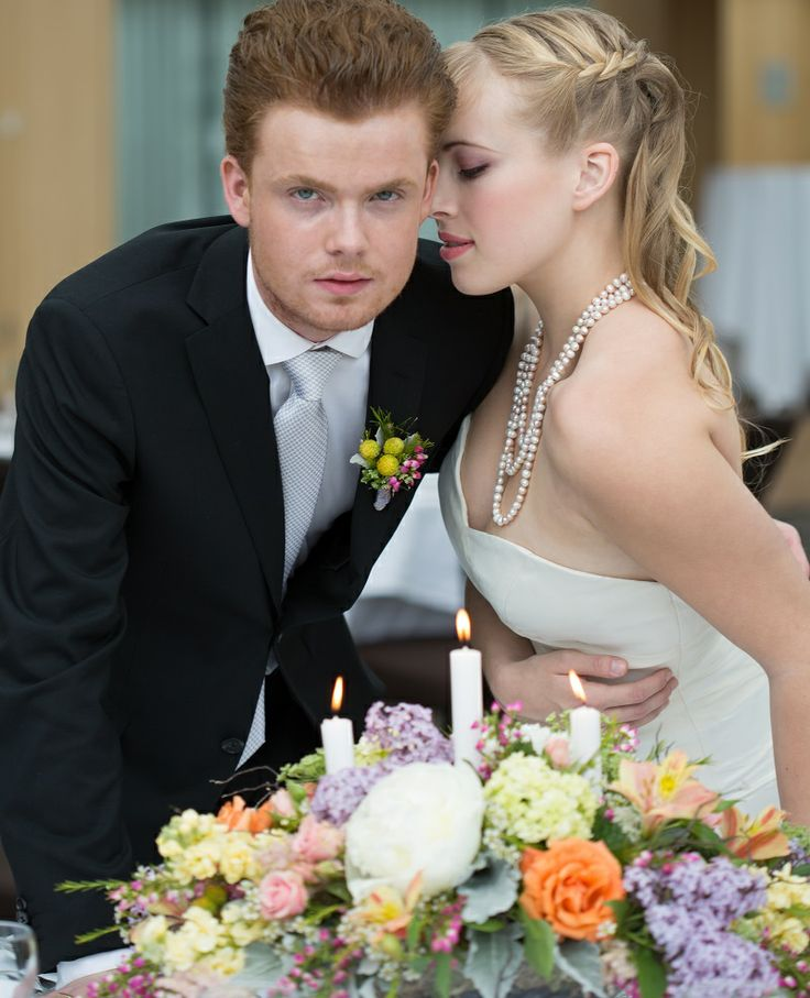 Photos: Vivid Photography Venue: Inn at Laurel Point Gown and Accessories: The Brides Closet Decor and Cake: Inn at Laurel Point Hair: Maffeo Salon and Day Spa Makeup: Erin Bradley Makeup and Styling Menswear: Outlooks by Men Floral: Chocolate Lily Floral Design
