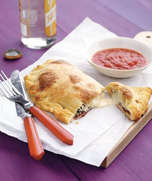 Three-Cheese Calzones - I love to make homemade pizza but never thought to make calzones. Def doing this next time, then we can all have our own!