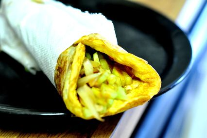 Favorite street side snacks from Bengal where a paratha is stuffed with egg and vegetables.