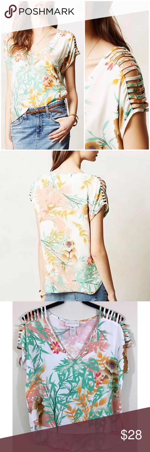 """Anthropologie Capuchin Monkey Cutout Sleeve Top With chic shoulder cut-outs, this silky tee's tropical print features playful monkeys. • By Corey Lynn Calter • Pullover styling • Polyester • Dry clean • Underarm to underarm laying flat measures 19"""" across, shoulder to hem measures 20"""" in front, 22"""" in back  • $98 retail, in great condition Anthropologie Tops Blouses"""